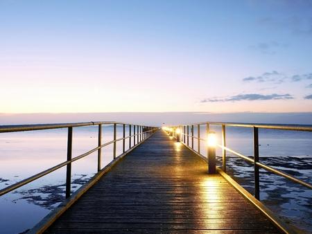 Foot bridge. Sea bridge. Wet and slippery wooden floor, above constrution smooth sea.