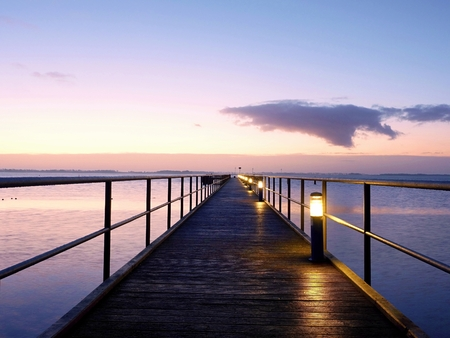 foot bridge: Foot bridge. Sea bridge. Outstanding jetty construct goes towards open water and horizon on a blue morning.