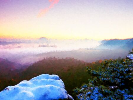 Watercolor paint effect. First powder snow cover on sandstone rocks above valley park. Heavy mist in valley bellow Stock Photo