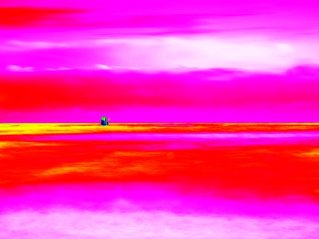 Ultraviolet  scan. Infrared  photo. Boulder sticking out from smooth wavy sea. Evening wavy sea. Dark horizon with the last sun rays. Stock Photo
