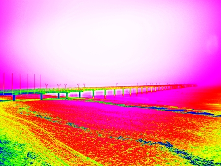 Ultraviolet  scan. Infrared  photo. Empty wooden mole on blue sea. wharf for hired boats in marina. Ready for trip ships.