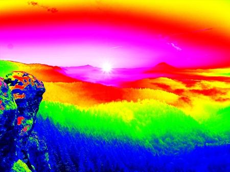 Ultraviolet  scan. Infrared  photo. Freeze autumnal daybreak, rocks covered with fresh powder snow. Stony rock peak increased from fog Reklamní fotografie