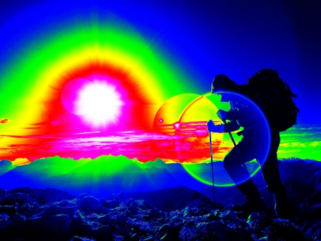 Ultraviolet scan. Infrared photo. Lens flare light, strong defect. Man hiker with rucksack walk on a rocky peak.