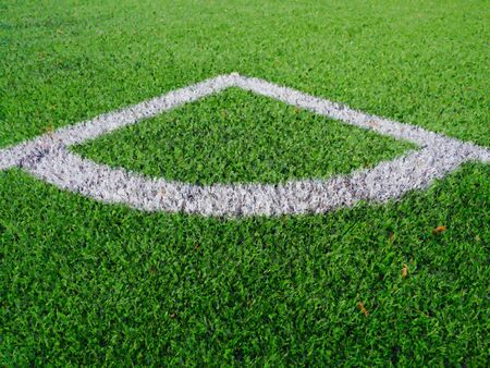 Watercolor paint effect. Football playground corner on heated artificial green turf ground with painted white line marks. Milled black rubber in basic of ground.