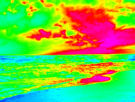 Thermography measurement, changed colors of ultra violet light. Stony ocean beach with big boulders. Thermography effect. Stock Photo
