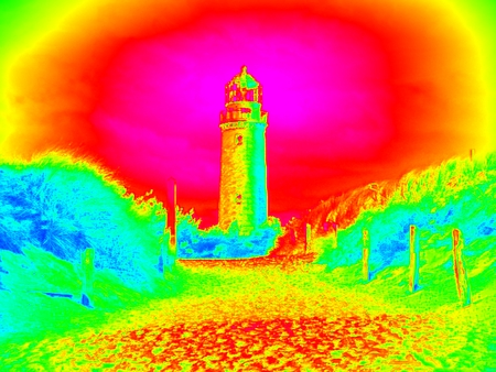 Infra scan, thermography photo. Lighthouse tower above sand dunes by sea. Seascape and landscape.  Animal view effect. Stock Photo