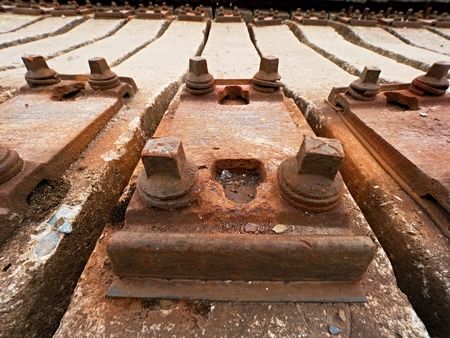 Used sleepers stock in railway depot. Old, dirty and rusty used concrete railway ties stored after big reconstruction of old railway station.