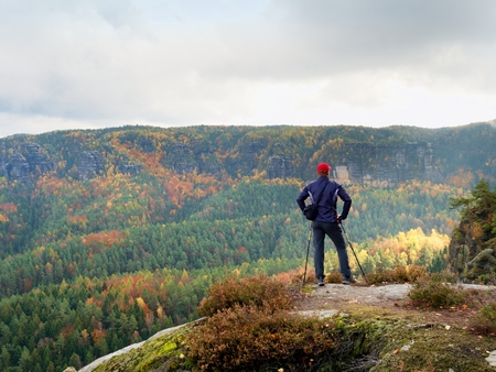 strip shirt: Hiker in sportswear stand on the peak of sandstone rock in rock empires park and watching over the valleys colorful autumnal Sun. Beautiful colors, the miracle of nature