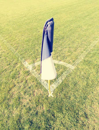 White blue flag in corner of football playground, lazy wind blowing Stok Fotoğraf