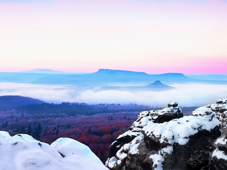 Abstract colorful mountains and colorful sky during sunrise and sunset. Red daybreak. Misty sunrise in the mountains, the gradation of color clouds. Stock Photo