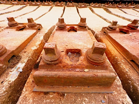Extracted old concrete sleepers in stock. Old  rusty used concrete railway ties stored after big reconstruction of old railway station.