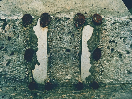 metal grate: Steel or iron rod in concrete mass, detail on construction site. Concrete railway ties Stored for reconstruction of old railway station. Stock Photo