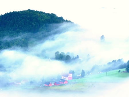 the magnificent: Heavy mist in landscape. Magnificent  autumn creamy fog in countryside. Hill increased from fog, the fog is colored to gold and blue