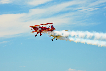 Memorial Airshow, 24th of June 2017, Roudnice, Czech Republic. Bucker Jungmeister in flight, smoke effect Editorial