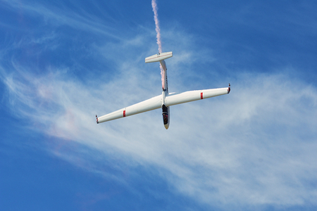 Memorial Airshow, 24th of June 2017, Roudnice, Czech Republic. Flying Glider aerobatic team withlight sailplane showing his performance, smoke effect Editorial