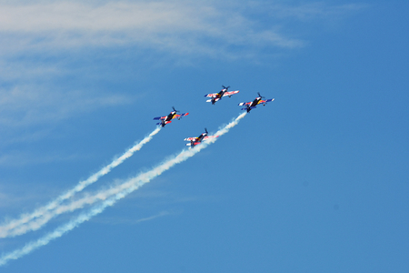 Memorial Airshow, 24th of June 2017, Roudnice, Czech Republic. Flying Bulls aerobatic team with ExtremeAir XA42 planes showing his performance. Red Bull plane team