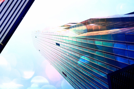 Film grain effect. High rise office tower with blue windows and blue sky. Modern office building,  skycrapers in business area