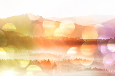 Film grain effect. Amazing  daybreak in Saxony Switzerland park. Sandstone peaks increased from foggy background
