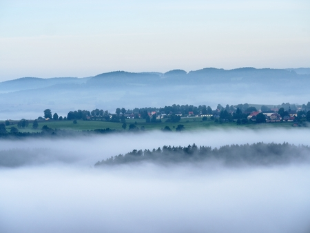 inversion: Autumn inversion fog. Peaks of hills increased from foggy background.