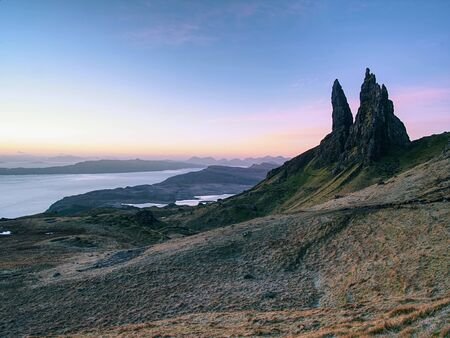 Old Man of Storr rocks with clear sky Isle of Skye Scotland, cold February morning
