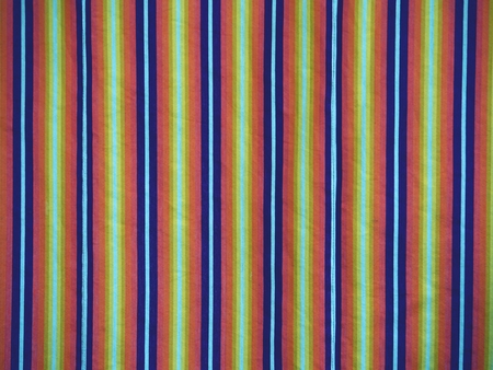 Colorful striped curtains cover window in hall. Wavy colorful fabric curtains , striped pastel tone