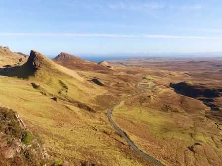 View from Quiraing mountains into vallley. Amazing hilly landscape of Isle of Skye, Scottland.  Sunny winter middaywith clear sky