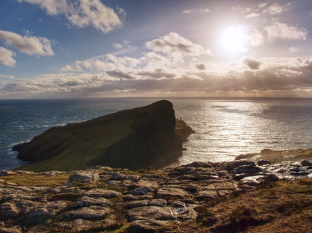Famous look at Lighthouse on the cliff of Neist Point, rugged and rocky coast on the western side Isle of Skye, Scotland, United Kingdom, Europe Stock Photo