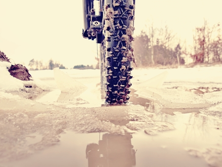 The wheel fell into the muddy puddle while winter mtb trip. Water hidden under snow.