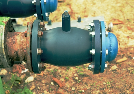 Renewal piping with ball valves and blind member. Pipe fittings joint with new screws and nuts. Repairing process to connect heating steam supply. Stock Photo