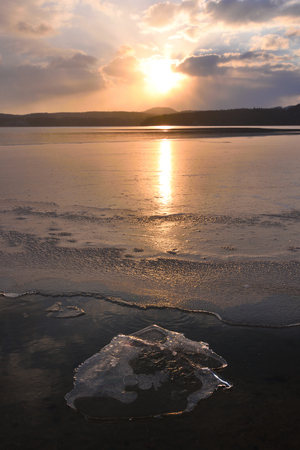 Ice and water near the mountain on the frozen Lake , wet circle