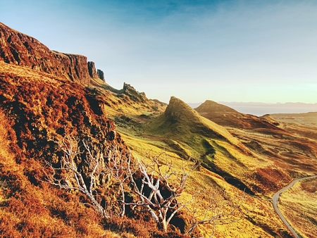 Sunny morning in Quiraing mountains. Hilly landscape of Isle of Skye, Scottish Highlands. Breathtaking view
