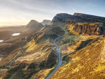 Empty Curvy Road in Scottish Highlands. Northwest Part of Quiraing Hill,  on the Isle of Skye in Scotland