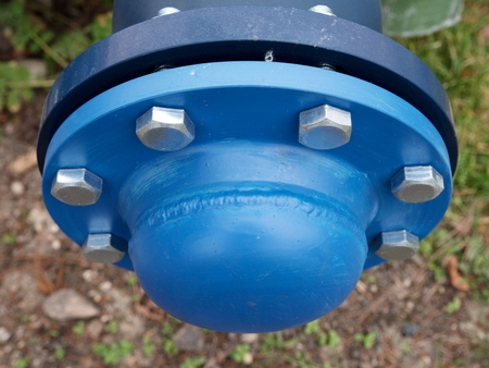 The still balancing ball valve with socket cover. Flanges with silver screws and nuts. New valves on old pipes. Stock Photo