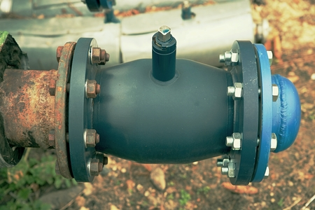 The central hot steam heating system. Pipelines with ball valves after repairing. Steel pipelines covered with heat insulation,flanges with bolt and nut