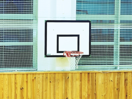 Basketball hoop and billboard sport in the school gym. Empty gym after training