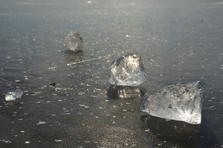 Abstract of frozen lake, textured pattern in pieces of ice. Flat glass surface of cracked ice in bay.