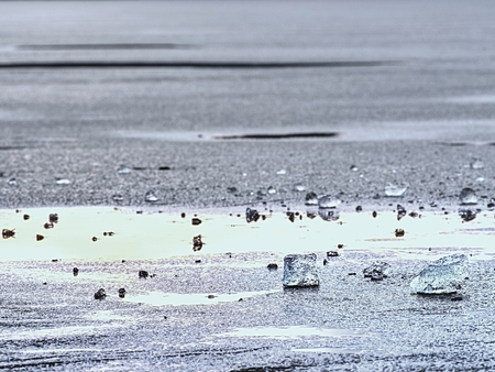 Winter coastal under icy cover. Icy andscape with broken pieces of blue  ice. Colorful toned photo with filter effect