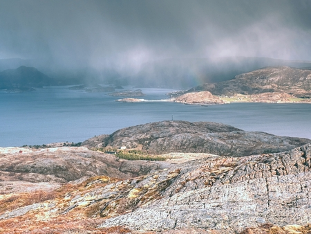 Aerial view to bay with fishing village. Distinctive scandinavian scenery with dramatic mountains, open sea and sheltered bays, beaches and untouched lands.