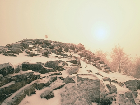 Winter scenic of trek in mountains with mist and snowfall , dangerous weather