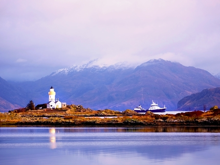 Popular view to Isle Ornsay Lighthouse. Rocky island south-east of Isle of Skye; Scotland, United Kingdom.