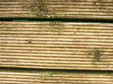 Dirty old weathered outside wooden plank wall. Outdoor terrace flooring Reklamní fotografie