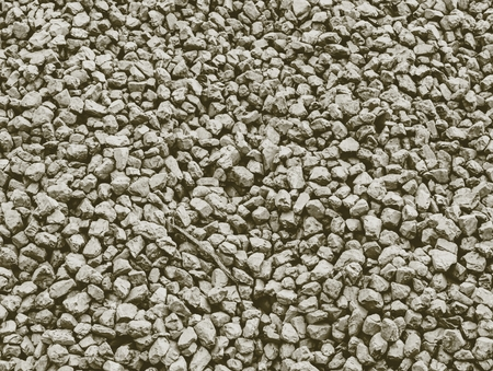 Detail of low quality coal in heap. Crushed anthracite at mining factory. Stock Photo
