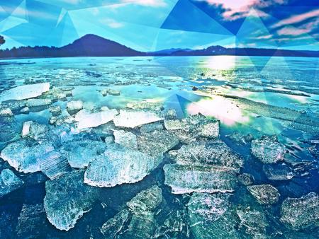 clear natural ice on frozen lake, very close up view. Early mealting of ice, highlightings of ecology problem.. Hipster filter.