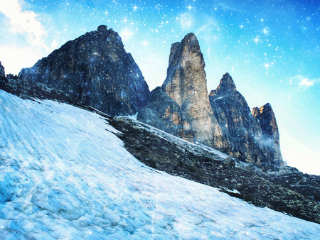 Tre Cime di Lavaredo in sunny April evening, view from tour around at sunset, Dolomite Alps Italy.  Hipster filter.