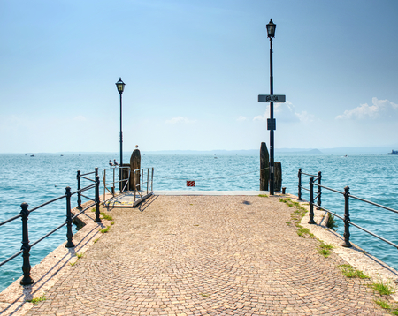 Veiw to the Garda lake from pier, summer holiday in Italy.