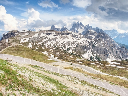 Asphalt road to parking place for motorhomes in National Nature Park Tre Cime In the Dolomites Alps, Italy.