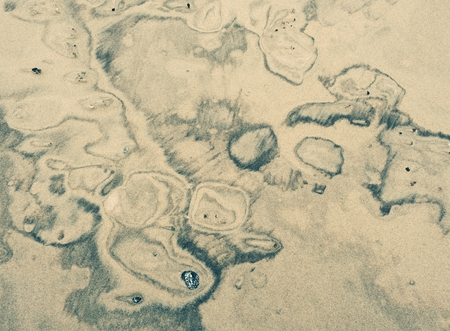 Sediments in wet sand created natural kind of picture.  Swirls with a soft, smooth and sandy texture. Reklamní fotografie