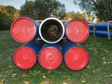 Thick wall pipe tube. HDPE potable storage pipe, HDPE pipeline. Long plastic tube on ground at building site