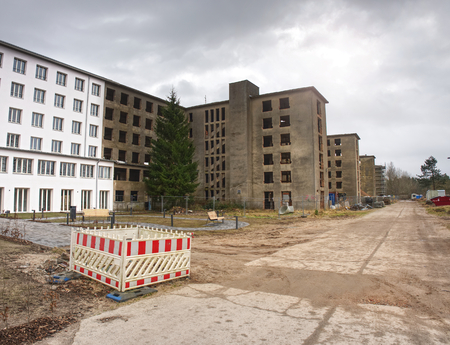 Restoration of flat houses. Concrete Buildings with broken windows at Prora Ruegen Germany 写真素材