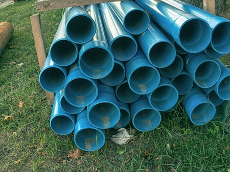 Bundle of plastic pipes ready for local water transit renewal.  Repairing process to connect drink water supply. Archivio Fotografico